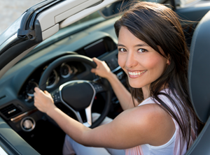 girl in new car after recieving an auto loan
